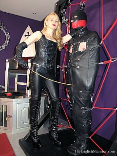 Everything is ready for extreme femdom torment to begin: blond Goddess is having man placed in the leather body bag and suspended on the BDSM rack