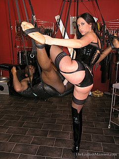 Black man undergoes the full range of strap-on humiliation down in the BDSM chamber. Put in love swing and abused by the busty dominatrix