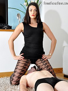 Lucky slave is undergoing femdom humiliation with a beautiful women: face slapped, caned hard and then smothered in black pantyhose