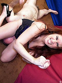 Dude has no chances of winning the fight with a sexy MILF in lingerie and heels: he ends un under her ass