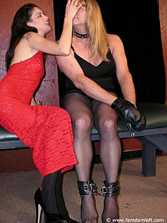 Handcuffed sissy had to sit still while femdom mistress is applying makeup to his face and selecting an outfit