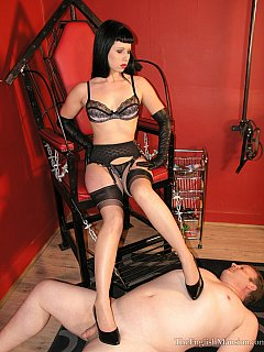 Petite dominatrix is only getting off her throne to trample naked man and use him as door mat