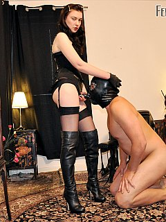 Mistress Severity Myers is operating strap-on and speculum in the scene where man is having his hole stretched nicely