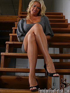 You have a choice to pleasure the perfect blond by worshiping her legs while she is wearing high heel shoes or barefoot