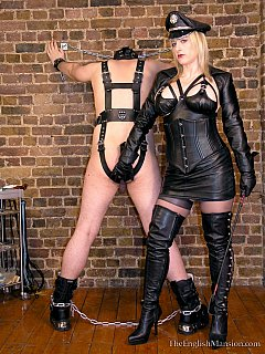 MILF bitch is dressed up in black leather military uniform and also making her slave wear BDSM harness and head mask