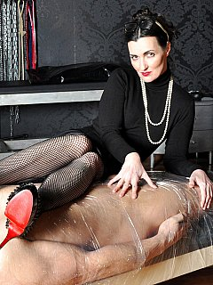 You will be taped to the table and smelling sexy female feet while evim mistress is going to be penetrating your penis with steel and her finger