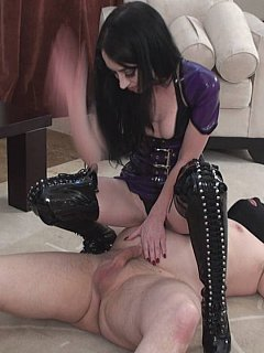 Professional dominatrix is teaching amateur girls the right way of punishing a man:by holding him by the penis and striking exposed balls