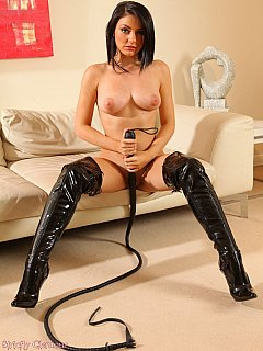 Whipping mistress has a lot of kinky PVC clothing but she prefers operating the whip all naked and in knee-boots