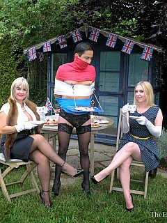 Ladies Sidonia Von Bork and Nina Birch are having a nice tea party in the backyard while tied up sissy slave is serving them