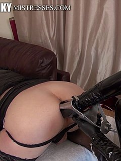 White sissy is posing doggy-style in front of the black mistress while she is violating his ass with the biggest speculum ever seen