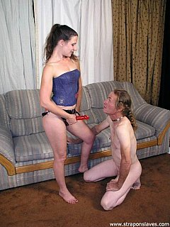 Well-trained slave is always going on all fours and opens his ass for a strap-on after just one command mistress gives him