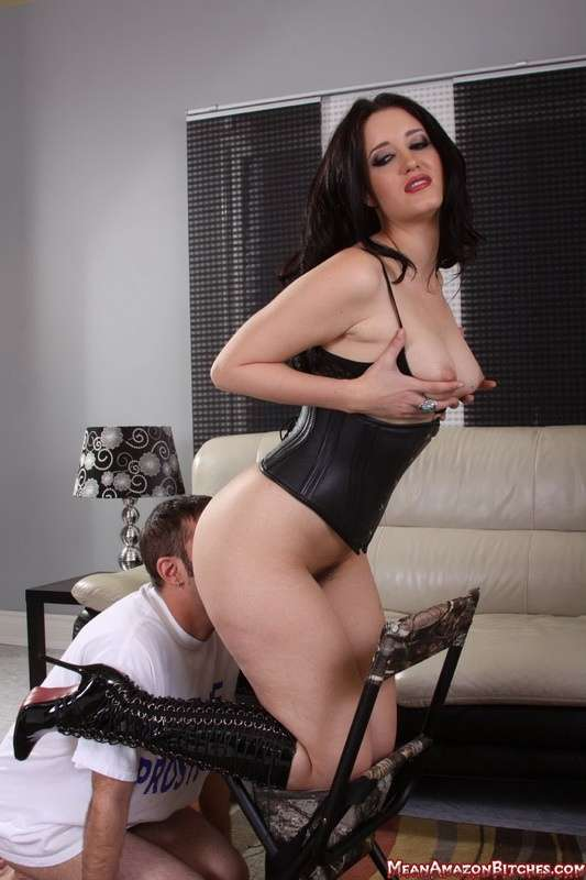 Picture #2 of High heel boots and leather corset is the sexy outfit Goddess is dominating a man in