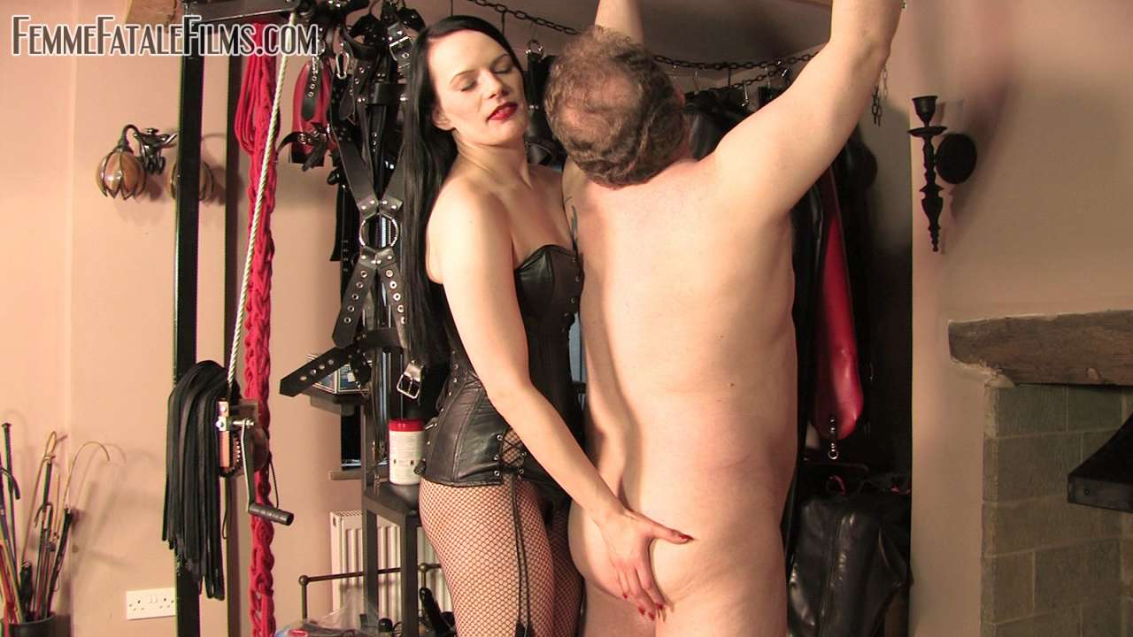 Picture #1 of It is nice and exciting for a man to feel his ass getting slapped and back whipped by naughty redhead while he is nude, handcuffed and helpless