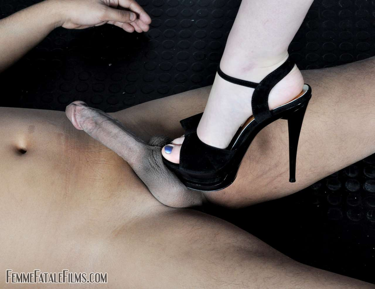 Picture #4 of Sexy fetish mates are stomping penis with high heel shoes getting slave ready for full-force balls kicking