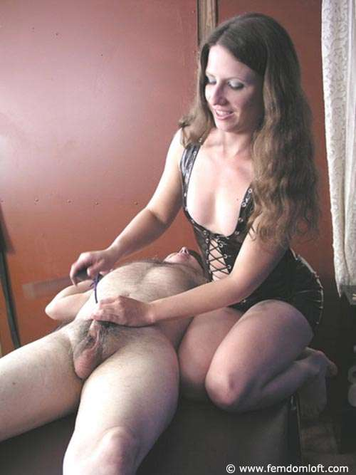 Picture #3 of There is not much a man can do except enjoying the pain once tied spread with handcuffs and there is a girl beating his balls and smothering him with her ass