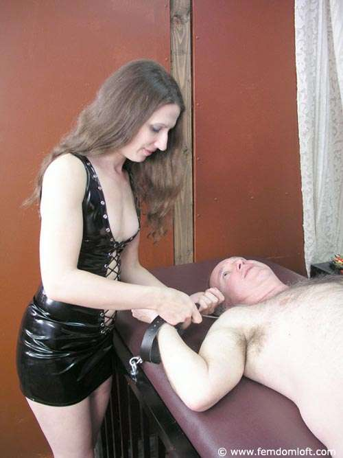 Picture #6 of There is not much a man can do except enjoying the pain once tied spread with handcuffs and there is a girl beating his balls and smothering him with her ass