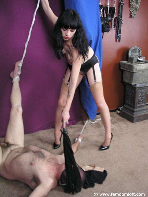 Picture #5 of A pleasure of being put in restraints, whipped and trampled by a beautiful nude girl in high heel pumps, stockings and garter belt