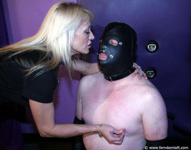 Picture #2 of Twisting nipples is what blond in pantyhose does to men when they are not submissive enough