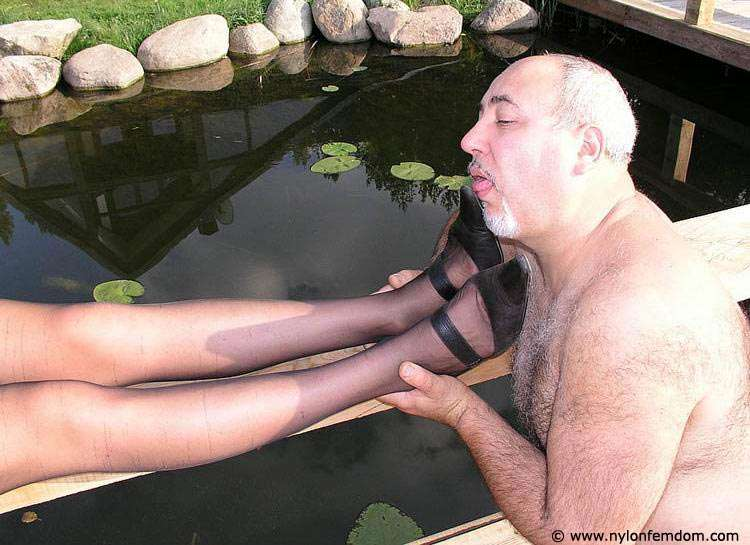 Picture #5 of Kinky couple is doing foot worship and trampling outdoors where everybody can see them