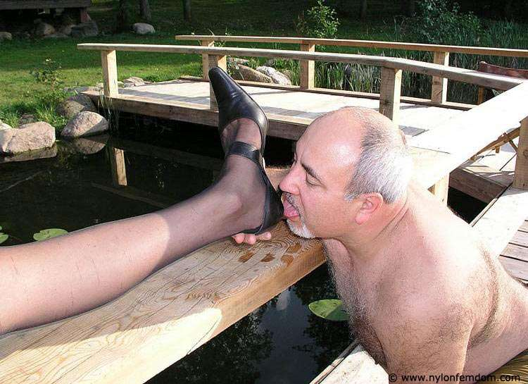 Picture #6 of Kinky couple is doing foot worship and trampling outdoors where everybody can see them