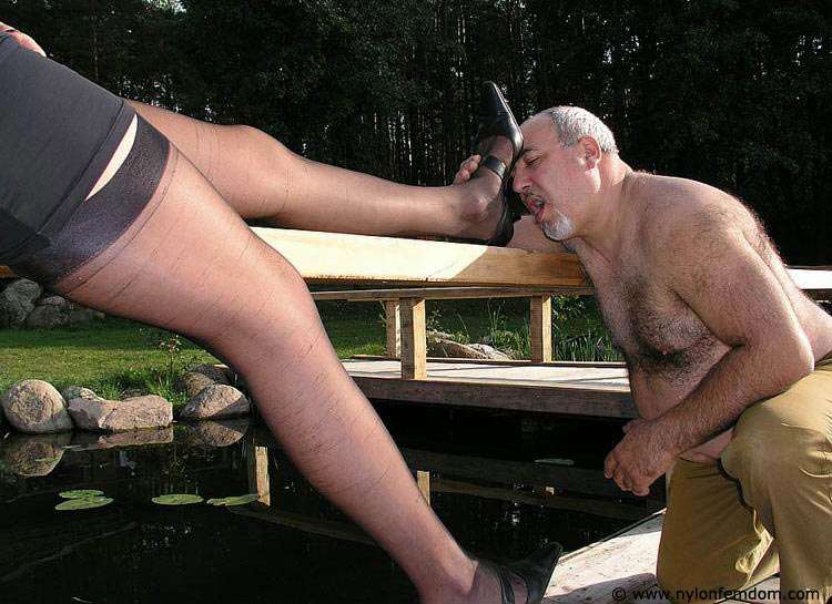 Picture #8 of Kinky couple is doing foot worship and trampling outdoors where everybody can see them