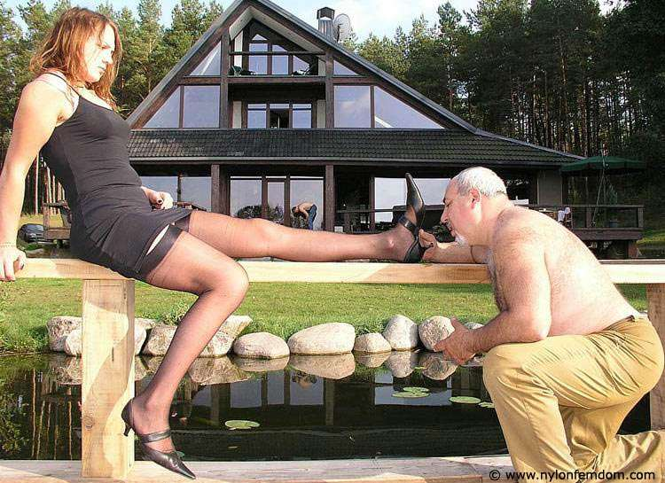 Picture #11 of Kinky couple is doing foot worship and trampling outdoors where everybody can see them