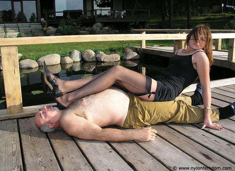 Picture #12 of Kinky couple is doing foot worship and trampling outdoors where everybody can see them