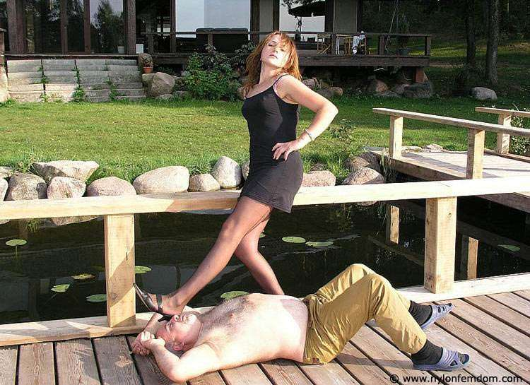 Picture #15 of Kinky couple is doing foot worship and trampling outdoors where everybody can see them