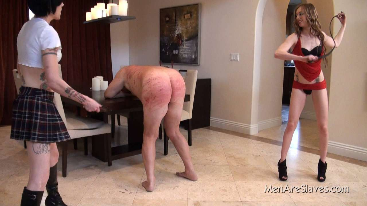 Picture #8 of A perfect team of bitches came up with kinky punishment: one is looking naked man in the eyes and does verbal humiliation while another girl is whipping his ass at the very same time