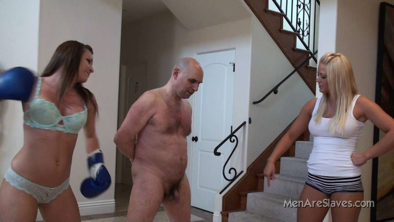 Picture #6 of A team of two sexy girls in lingerie are sharpening their boxing skills beating up naked man exposed in front of them