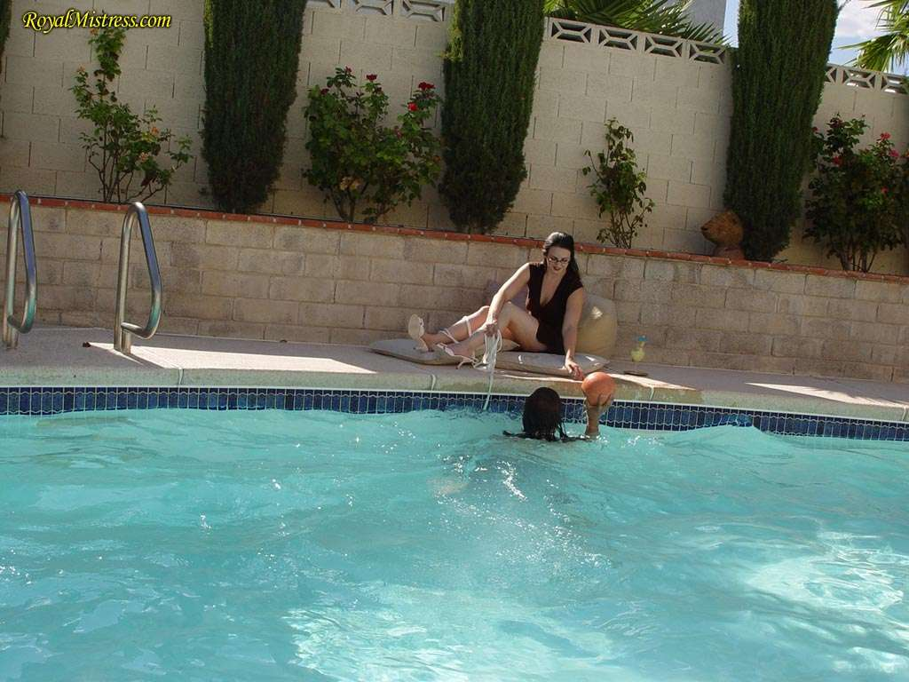 Picture #3 of Mistress is dragging the leash to get femdom slave out of the pool for another bare foot worship session she enjoys so much