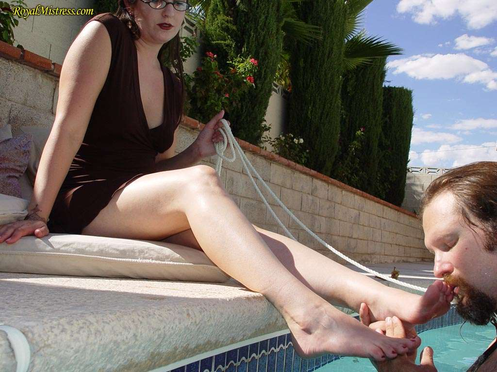Picture #10 of Mistress is dragging the leash to get femdom slave out of the pool for another bare foot worship session she enjoys so much