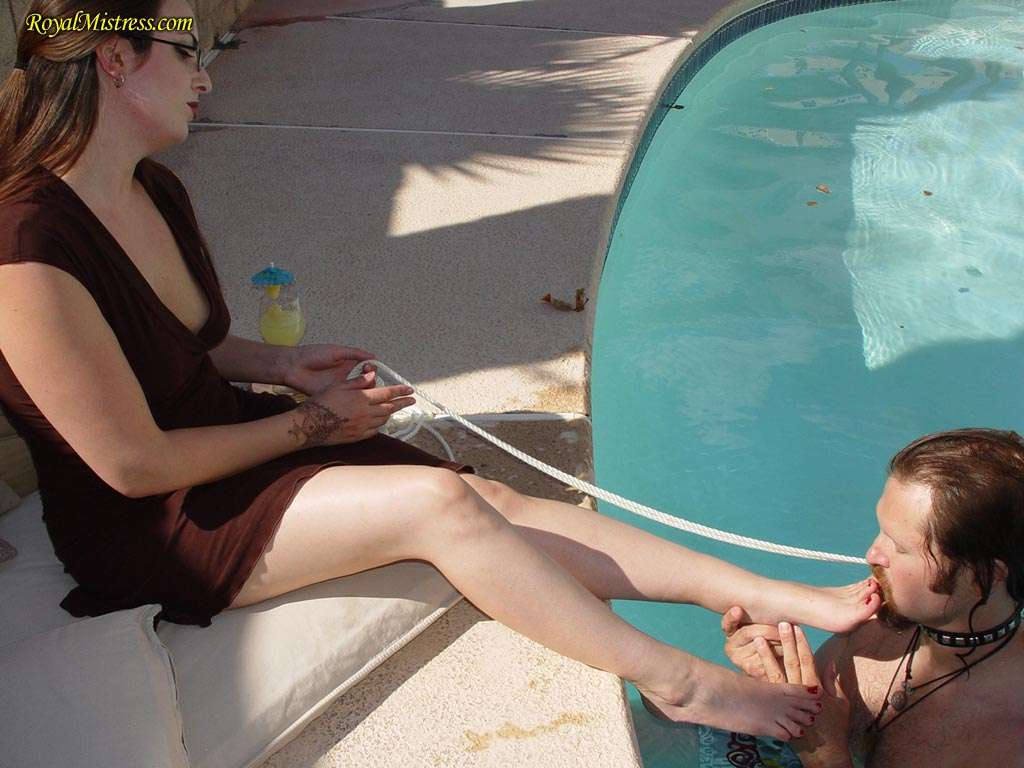 Picture #12 of Mistress is dragging the leash to get femdom slave out of the pool for another bare foot worship session she enjoys so much