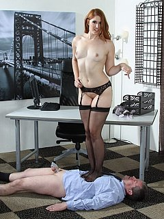 Boss knows his place: on the floor, locked into chastity device and made use of as a place to sit on by sexy secretary in lingerie