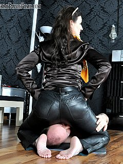 It should feel very nice to have a beautiful barefoot woman sitting on your face in tight leather pants