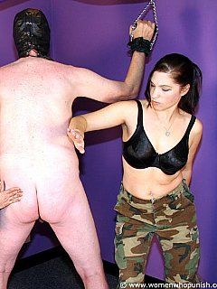 Military bitches in action: captured a man, cuffed him naked and spanking his ass hard