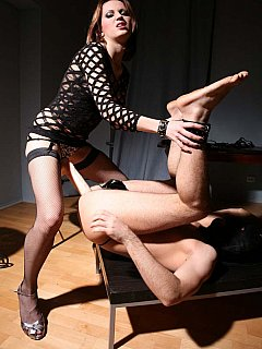 Dominant Goddess would smoke another cigarette before starting ass destruction process with massive rubber cock