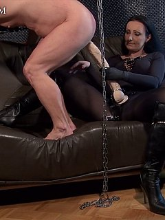 Goddess is having huge strap-on toy all well lubricated for male sissy slave to mount himself on top