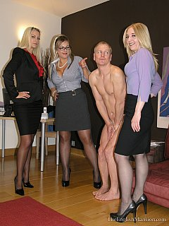 A bunch of bitchy secretaries forced their boss to strip, get on his knees and lick their cunts
