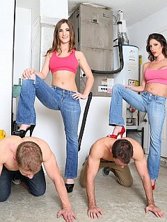 A couple of construction workers are in their knees and submitting to a couple of hot sporty girls in jeant