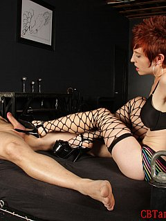 Expose naked men in bondage and tease their cocks with high heel shoes is what redhead bitch in fishnets enjoy doing