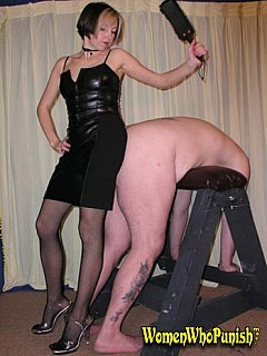 Petite mistress hurting her hands a lot spanking big fat ass so she is using black leather paddle instead
