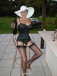 Gorgeous femdom lady is having a drink at the pool after a hard day where she punished a lot of men
