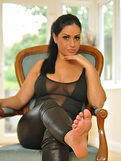 Wet look leggings and beautiful bare feet are your femdom menu for this leg worship session