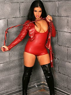 Glamorous femdom bitch dressed herself up in skin-tight rubber and have a whip in her hands: all is ready to give you some verbal humiliation