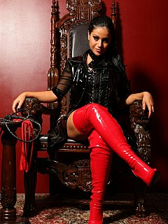 Throne is the place where beautiful dominant woman like this naturally belongs to. Crawl closer and ask for permission to lick slutty pink knee-boots