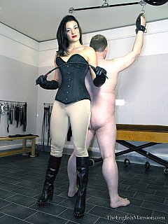 Classy lady enjoys dressing up for horse-raiding when dealing with miserable slaves: this guy is cuffed naked and subjected to corporal punishments