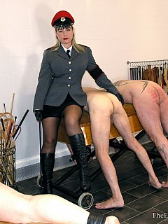 Military bitch is keeping strict discipline in her prison: all men are nude, bend over and treated with harsh canning
