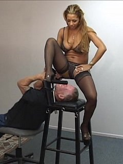 Busty MILF has special type of facesitting stool where she can put man in and then smother him the way she wants to