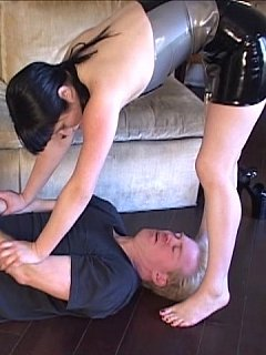 Dressing up in latex, tying men down and then using her crotch to smother them is how this babe spends her leisure time